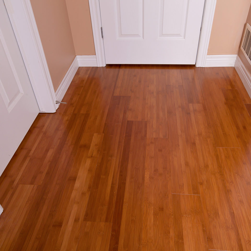 Modern interior bamboo hardwood flooring after renovation angled view