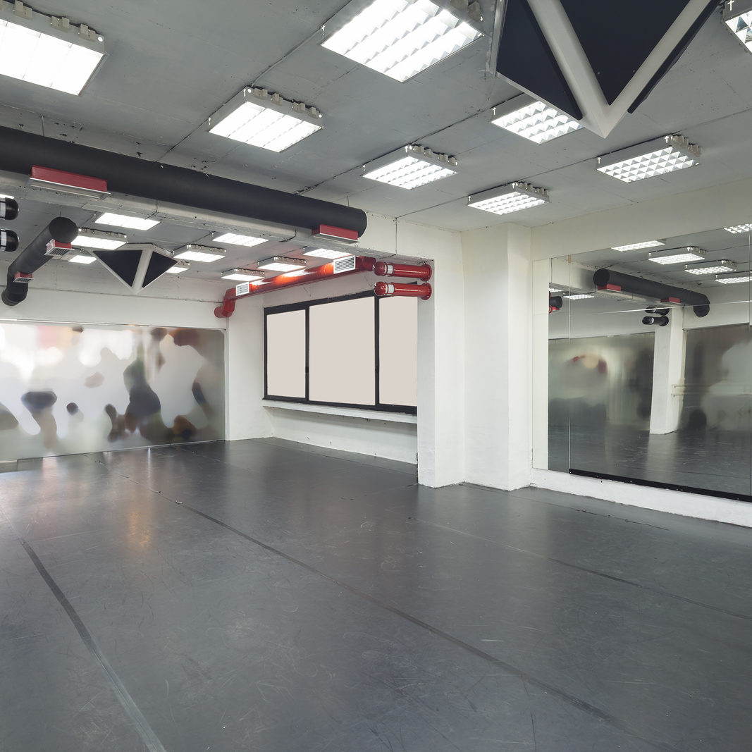 training and ballet room with a rubber floor